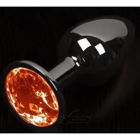 Графитовая анальная пробка с оранжевым кристаллом - 8,5 см.